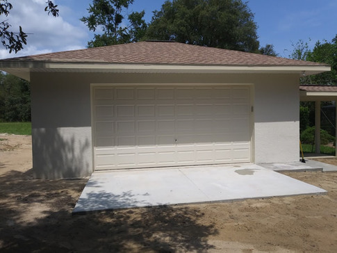 Custom garage by Rise Construction