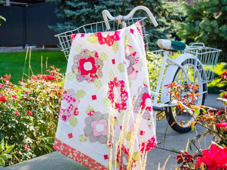 Rolling Petals Quilt - National Sew a Jelly Roll Day
