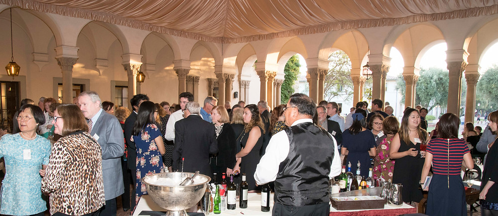 Guests enjoy pre-drinks before the enjoying performances by Mr. Martin Chalifour and Caltech students. Photo by Bob Paz