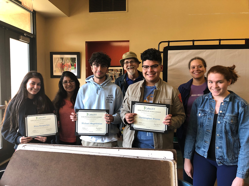 Rise Scholarship recipients receive their awards. (L-R) Nina Kasparian, tutor Zoila Juardo Quiroga, Michael Magrdchian, immediate past board chair Dan Erickson, Chris Flores, tutors Amy McCarthy and Hazel Dilmore.