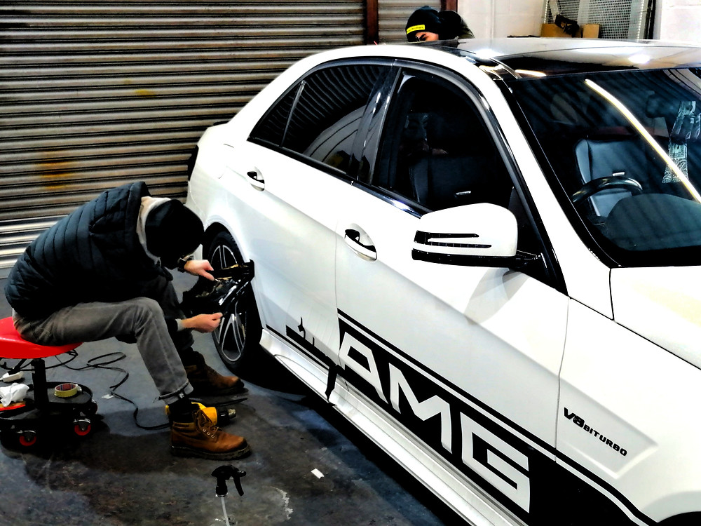 Wrap Brothers removing graphics. Mercedes-Benz E63 AMG