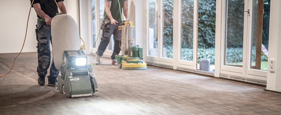 _Craftsmen sand a parquet floor.jpg