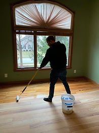 Rolling matte oil base finish on pine flooring