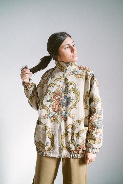 Jaqueta vestida de poltrona