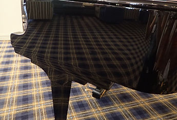 Scratches buffed grand piano