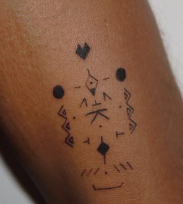 tatouage chamanique rune cosmique perso