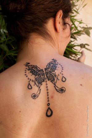 Tatouage chamanique papillon bijoux