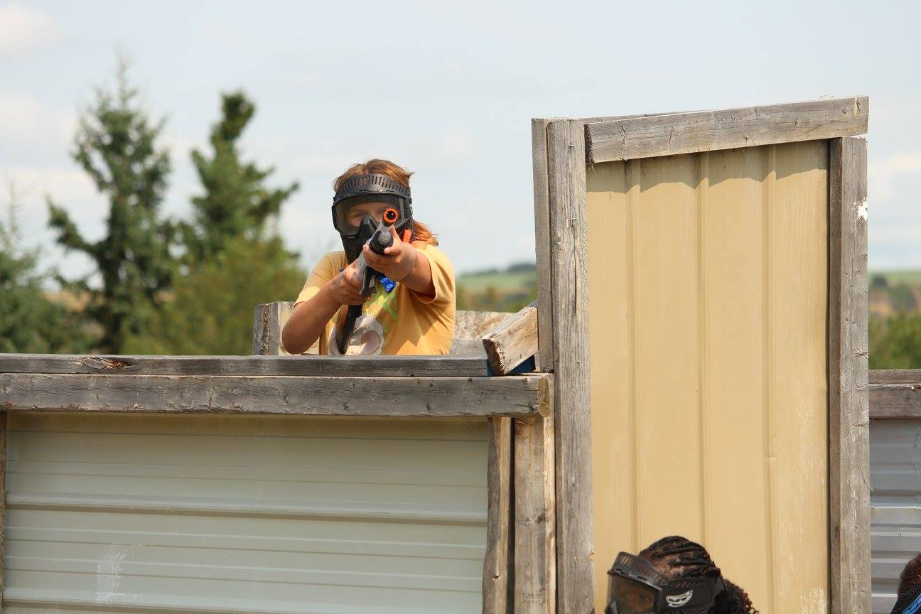 girl aiming an airsoft gun