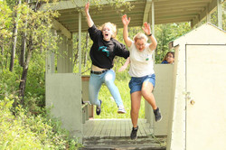 young adults jumping into the air