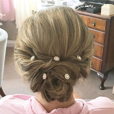 Low messy updo accessorised with diamant