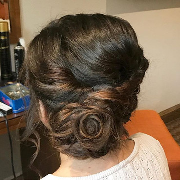 Twisted bun with plait coming around to
