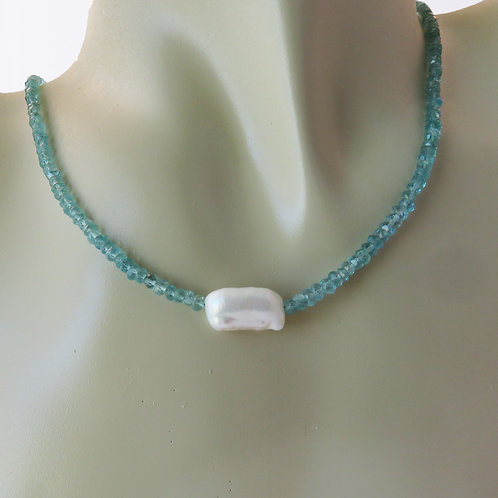 Apatite and Pearl Necklace Around Neck