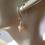 Golden Murano Glass Earrings on Ears