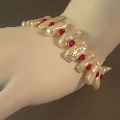 Stick Pearl and Ruby Bracelet Around Wrist