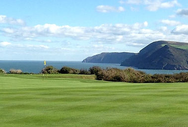View of a golf course overlooking the sea