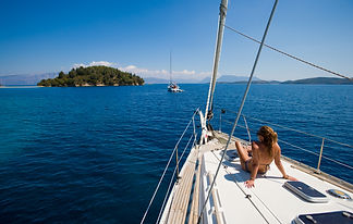 Young woman Sailing On Yacht in Greece .