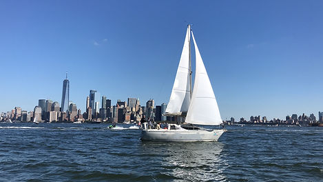 Team building and leadership skills on a sailboat in the New York Harbor