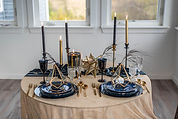This is an image of a sweetheart table with candles, place settings and celestial-style decor.