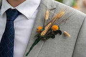 This is an image of a wheat and grass boutonniere.