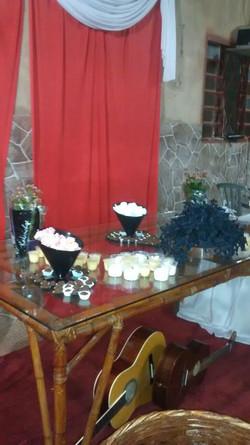 A mesa dos docinhos.