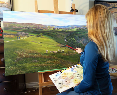 Canadian artist Sue Miller at the easel painting a landscape of the Yorkshire Dales.