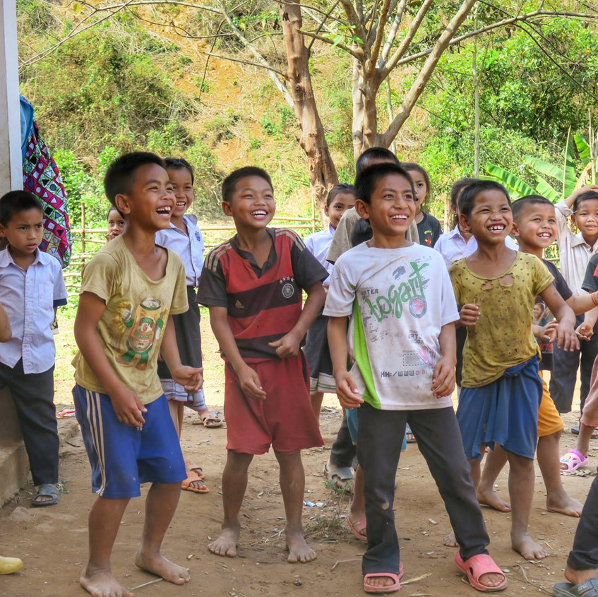 The children were given a balloon to play with. Such happiness from one small toy.