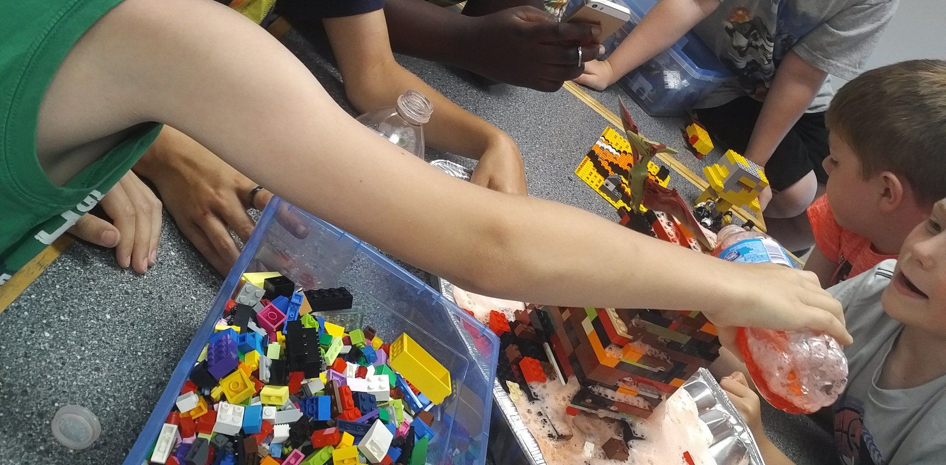 Erupting our LEGO volcano while Leader Ruth takes a video