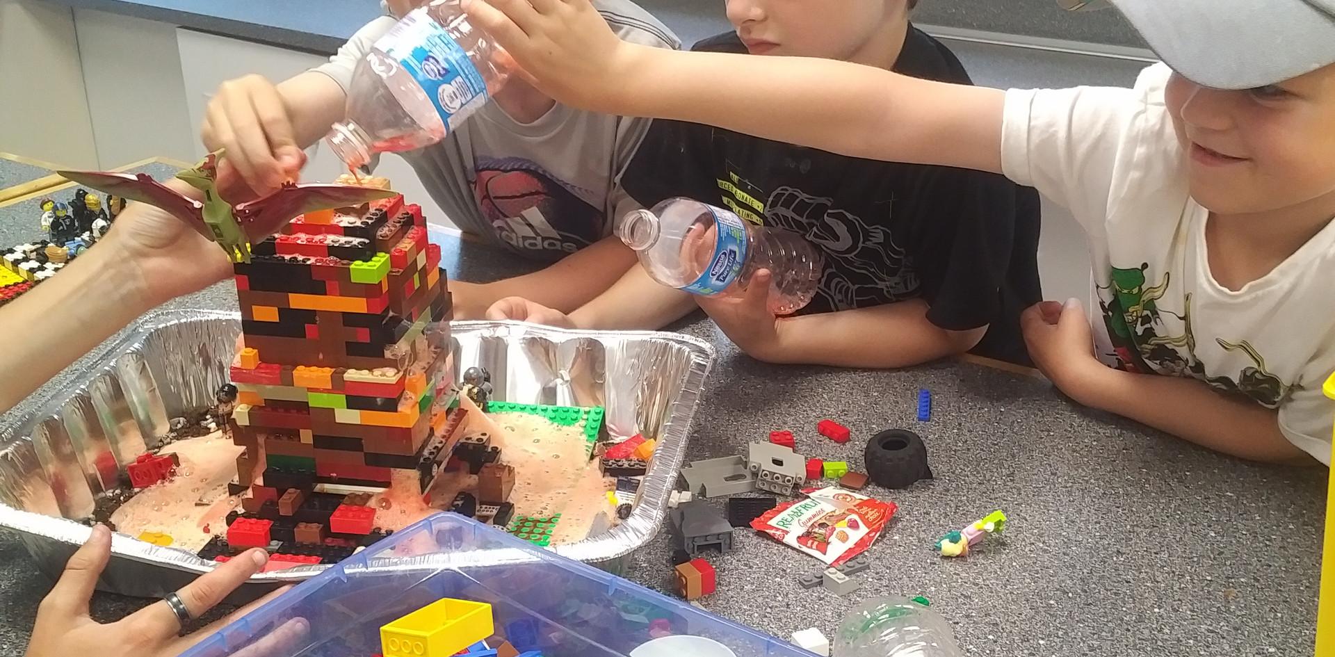 Taking turns destroying the LEGO village