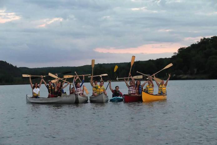 Canoes raising paddles.JPG