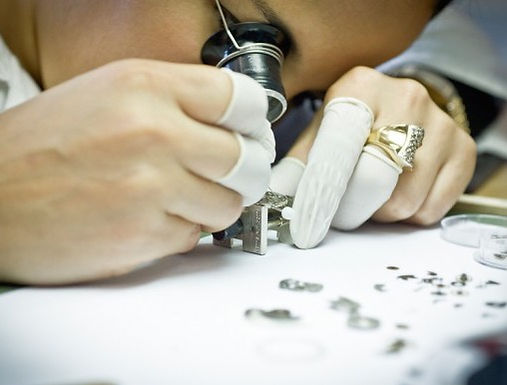 Watchmaker assembling a watch.
