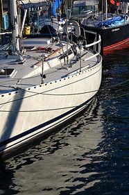 White Sailboat in Dark Water