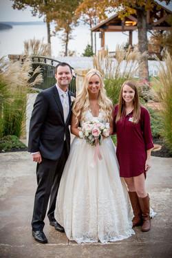 Kellie w/ the bride and groom