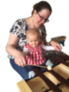 baby plays xylophone with Suzuki music class teacher