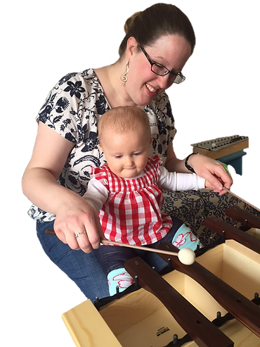 baby plays xylophone with Suzuki music class teacher