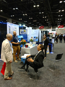 Picture of RGA team members at a booth