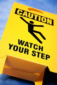"""Picture of sign that says """"caution watch your step"""""""