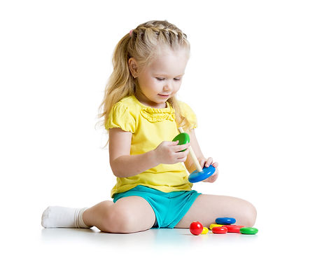 cute kid playing with color pyramid toy.jpg