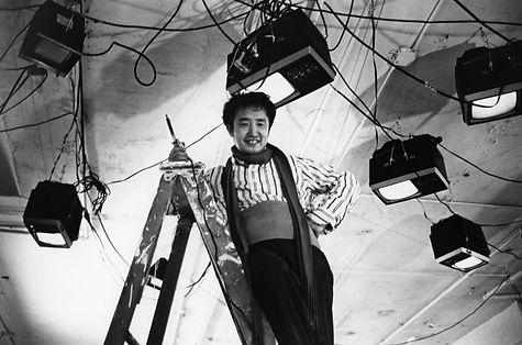 Paik installing Fish Flies (1976). Photo