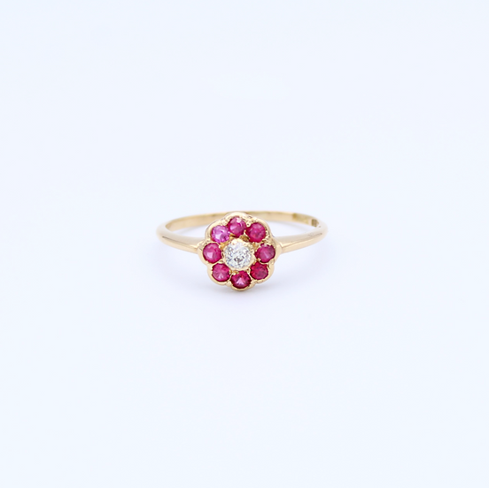Ruby and Diamond flower style rubbed over setting ring
