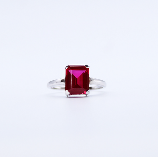 Red stone emerald cut ring