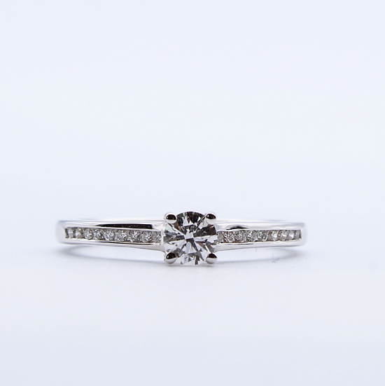 Diamond solitaire ring with diamonds on shoulders