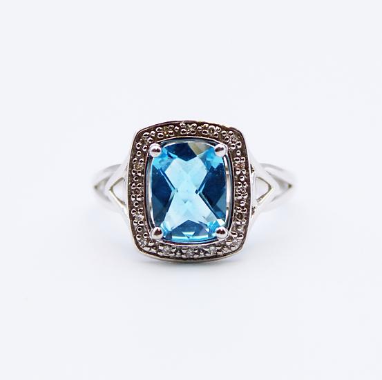 Blue Topaz and Diamond emerald cut ring