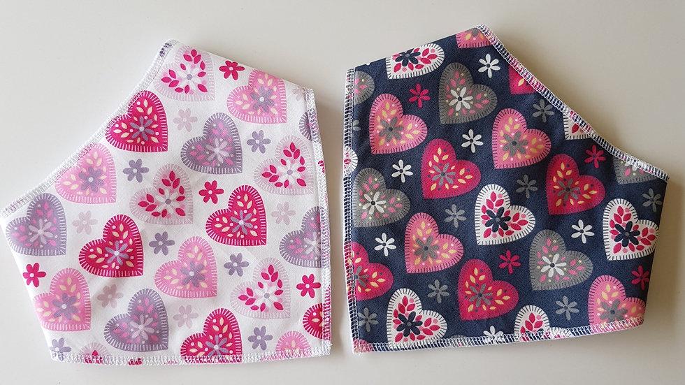 2 pack of heart print bibs