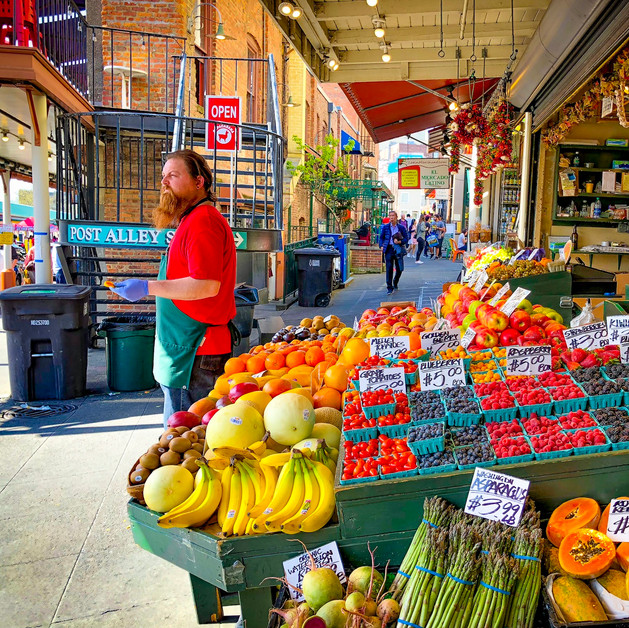 A produce monger at the Pike Place Market