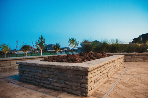 Custom Fire Pits & Fireplaces by Red Valley Landscape & Construction in Edmond