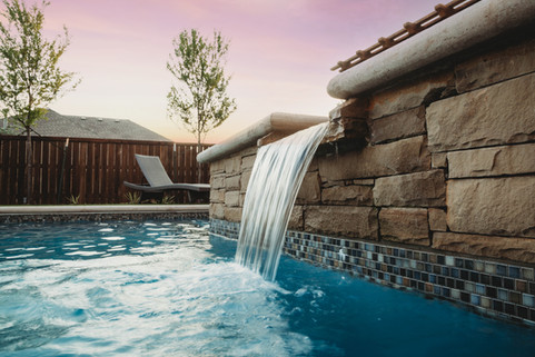 Custom Pools & Spas by Red Valley Landscape & Construction in Pflugerville, Texas