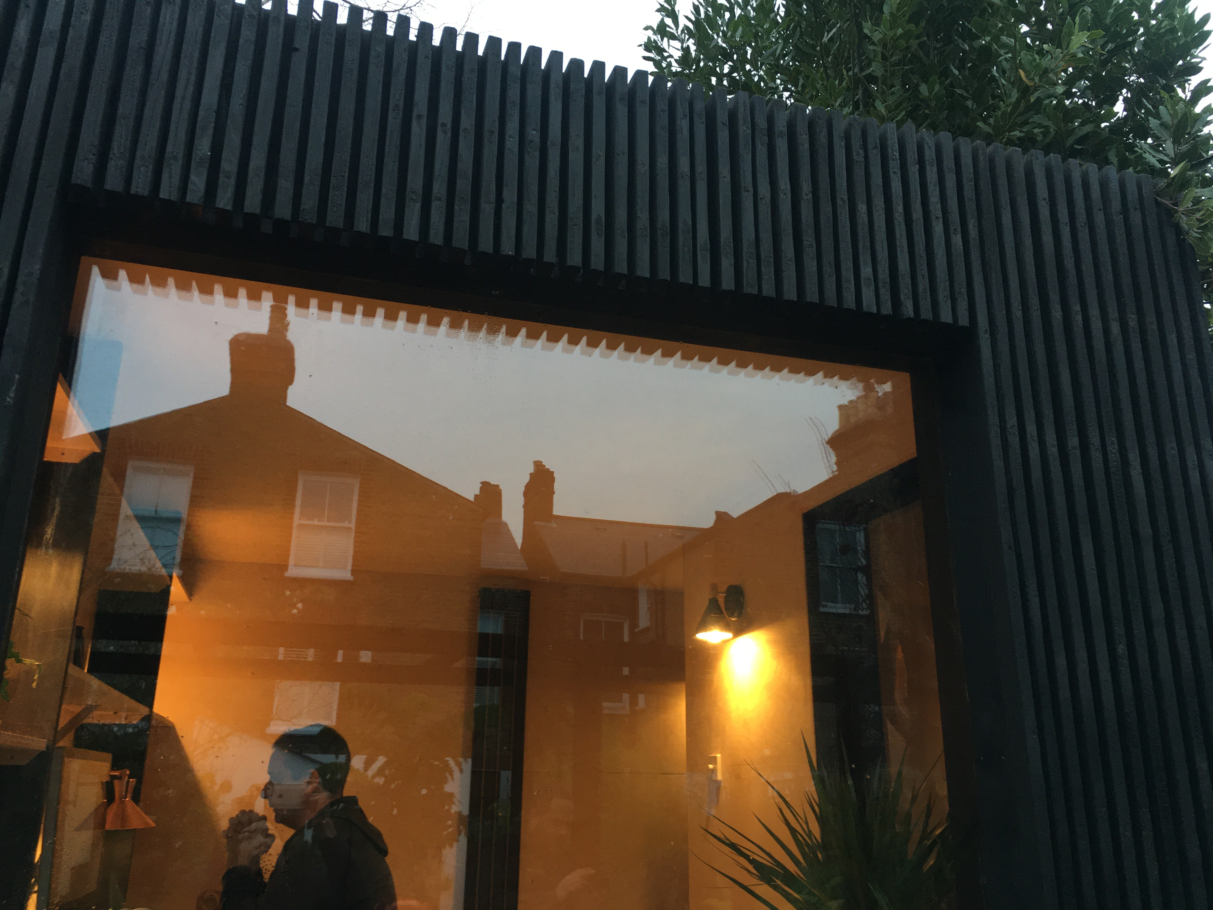 Exterior clad in charred larch battens