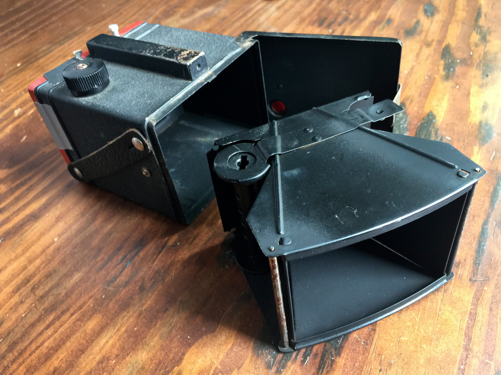 I love box cameras that open up like a treasure box. Such a simple, effective design. I wish I could identify the model of camera this is, but I have yet to find anything like it online. It's 3 plain metal sides, a top, and a front with a lens opening.