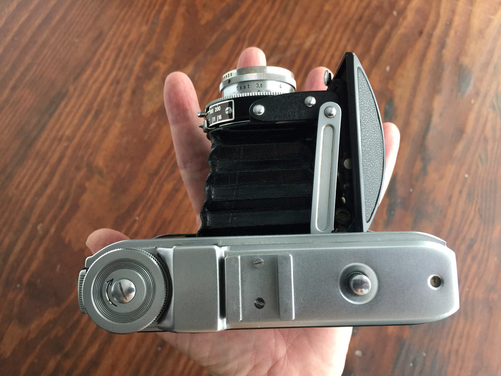 Even when it's fully opened, it's still a small camera. When it's folded down and closed up, it's small enough to toss in my purse or backpack without being obnoxiously bulky or heavy.