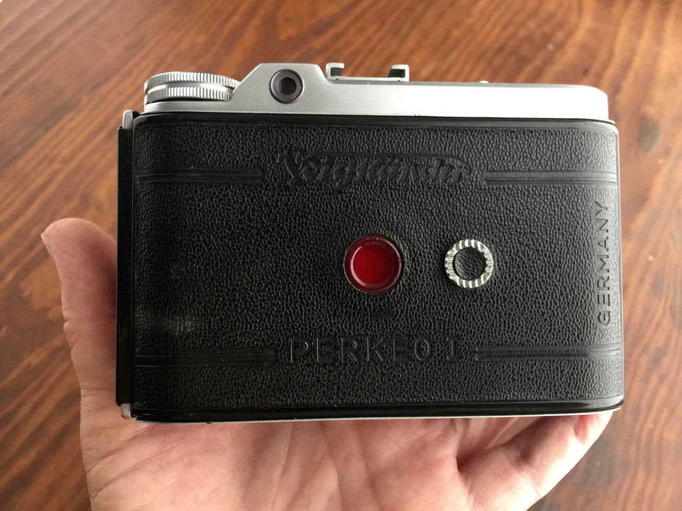 The back of my cute Perkeo, with the film counter window that has a little cover moved over it by that round disk beside it. What a sweet design this camera is!
